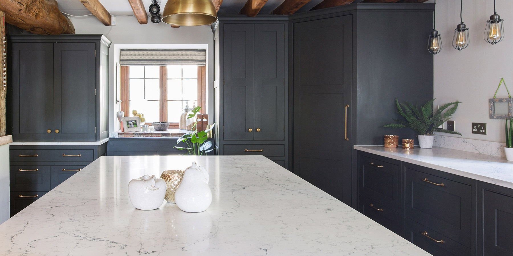 Industrial Style Shaker Kitchen - Handmade shaker kitchen cabinets with large kitchen larder and central kitchen island, with beautiful white worktops and brass handles.