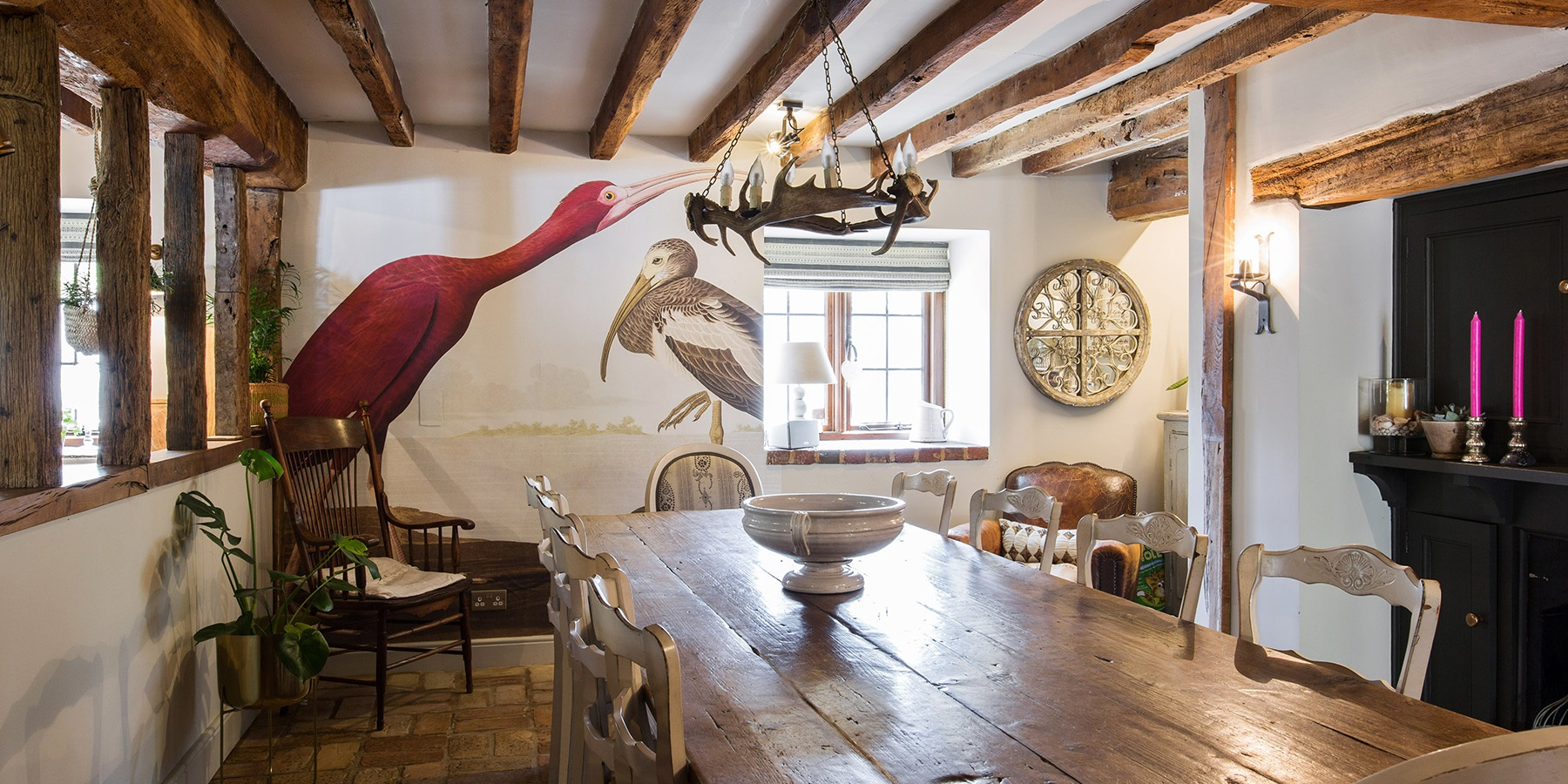 Rustic Oast House Kitchen & Dining Room - Beautiful authentic dining room with original wooden beams, open fire place and amazing bird wall mural.