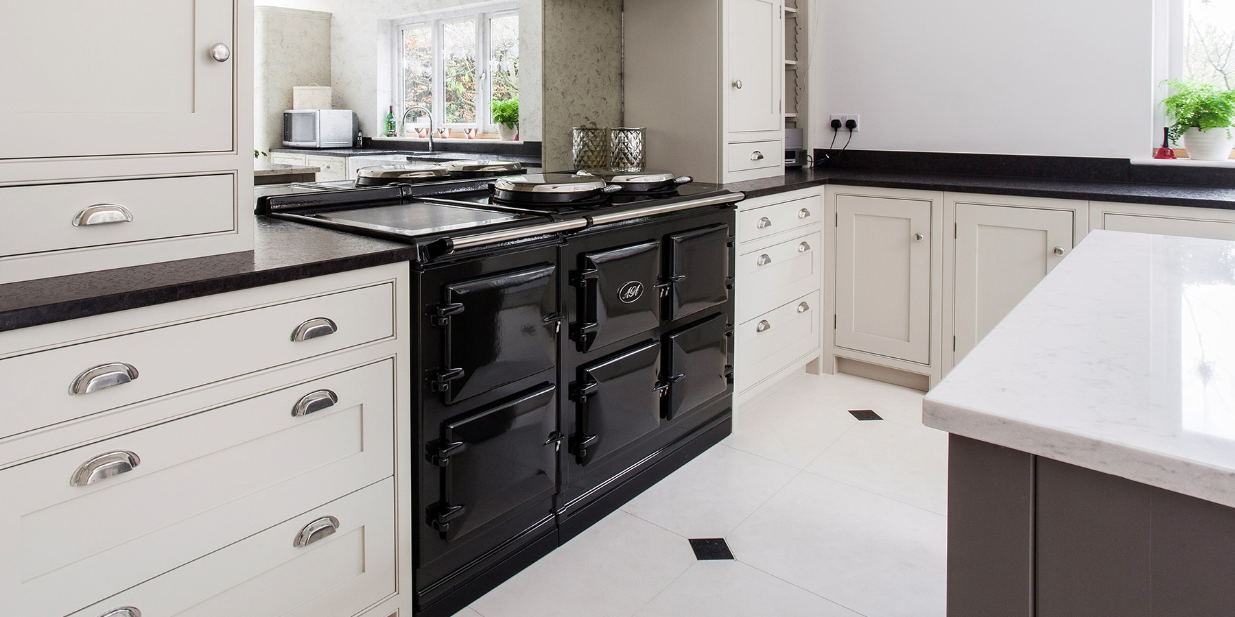 Bespoke Shaker Kitchen With AGA - Beautiful handmade Wellsdown cabinetry in white, with black worktops and black AGA Total Control.