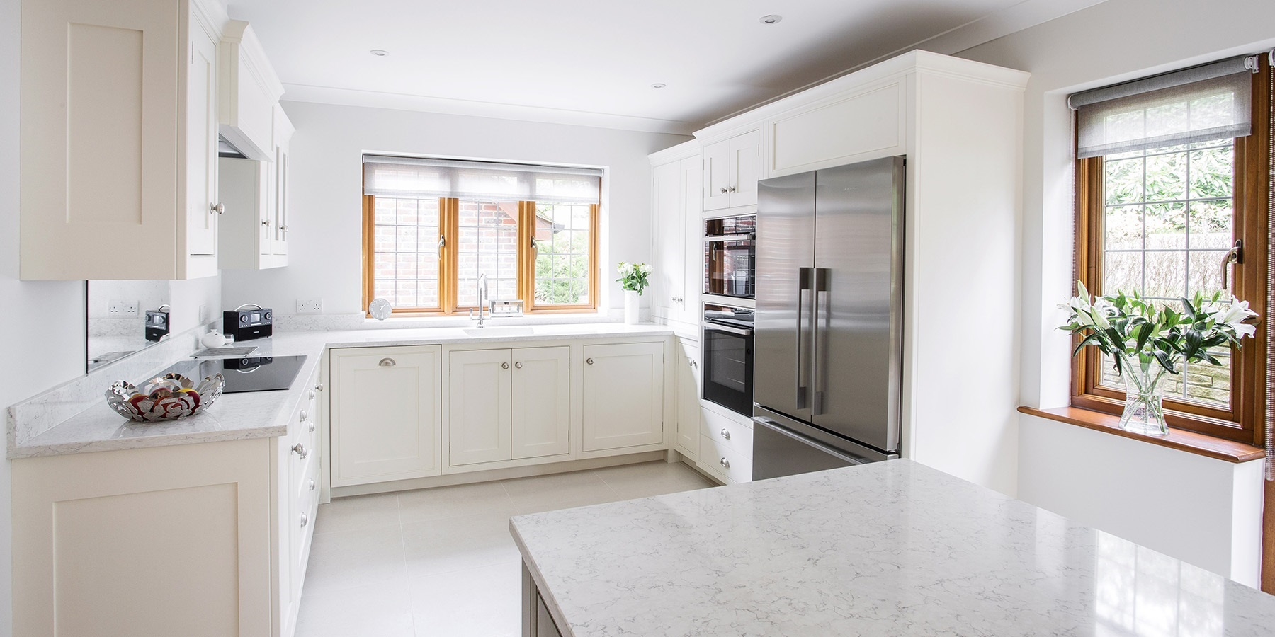 Contemporary White Shaker Kitchen - Contemporary handmade Wellsdown cabinetry with large silver fridge and appliances.