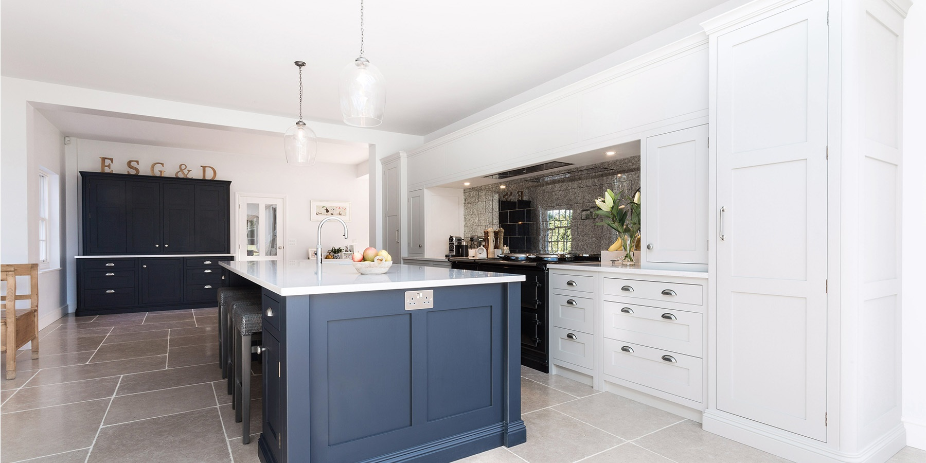 Luxury Open Plan Shaker Kitchen - Burlanes bespoke Wellsdown kitchen in navy and grey, with central kitchen island and breakfast pantry.