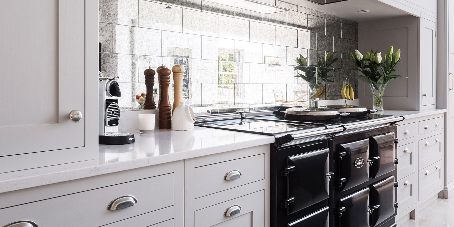 Luxury Handmade Shaker Kitchen & AGA - Burlanes handmade Wellsdown kitchen with beautiful mirrored tile splashback by Ca'Pietra, and AGA Total Control.