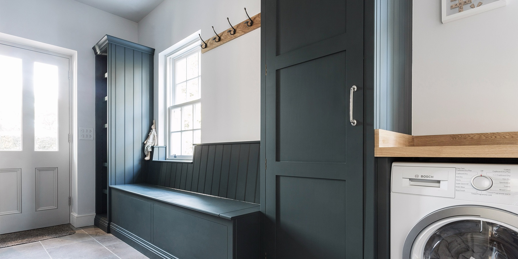 Handmade Utility Room & Bootroom Storage  - Burlanes handmade utility room and bootroom storage solutions with lift up banquette seating.