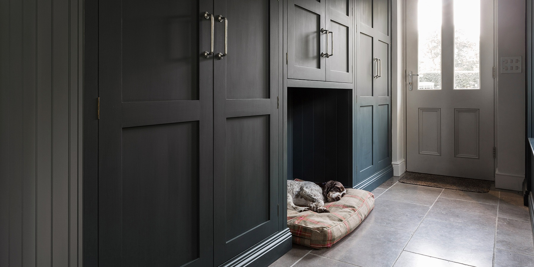 Handmade Utility Room & Bootroom Storage  - Burlanes handmade utility and bootroom storage with bespoke dog bed area and beautiful shaker panelling.