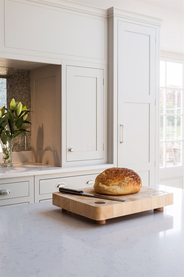 Luxury Handmade Shaker Kitchen - Burlanes bespoke Hoyden kitchen with white worktops, wooden chopping board and fresh bread.