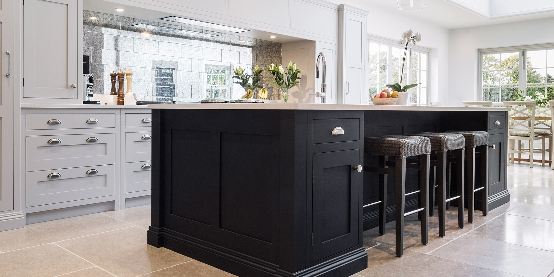 Luxury Open-plan Handmade Shaker Kitchen  - Burlanes beautiful handmade Hoyden kitchen, with central blue kitchen island and white worktops, mirrored splashback and Quooker boiling water tap.