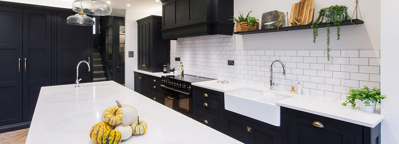 Industrial Nautical Shaker Kitchen - Burlanes bespoke Hoyden shaker kitchen in navy blue with white worktops, metro tiles splashback and beautiful central kitchen island.
