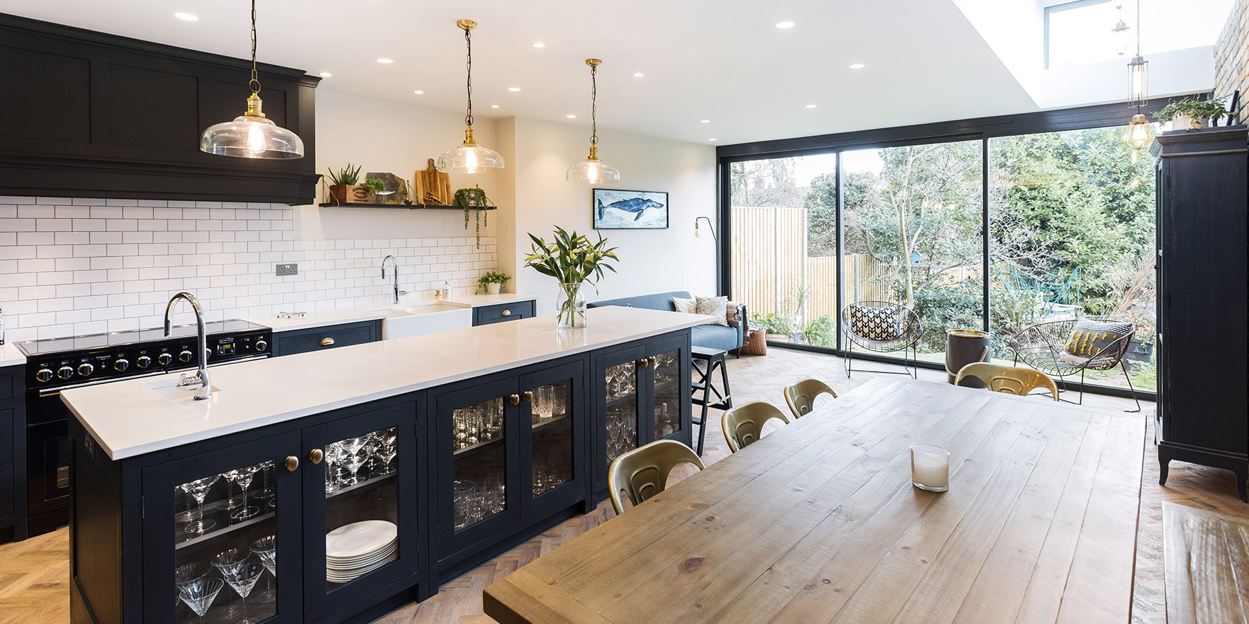 Open-plan Luxury Industrial Style Kitchen  - Burlanes bespoke Hoyden kitchen with an authentic industrial decor, beautiful dining table and amazing glass doors.