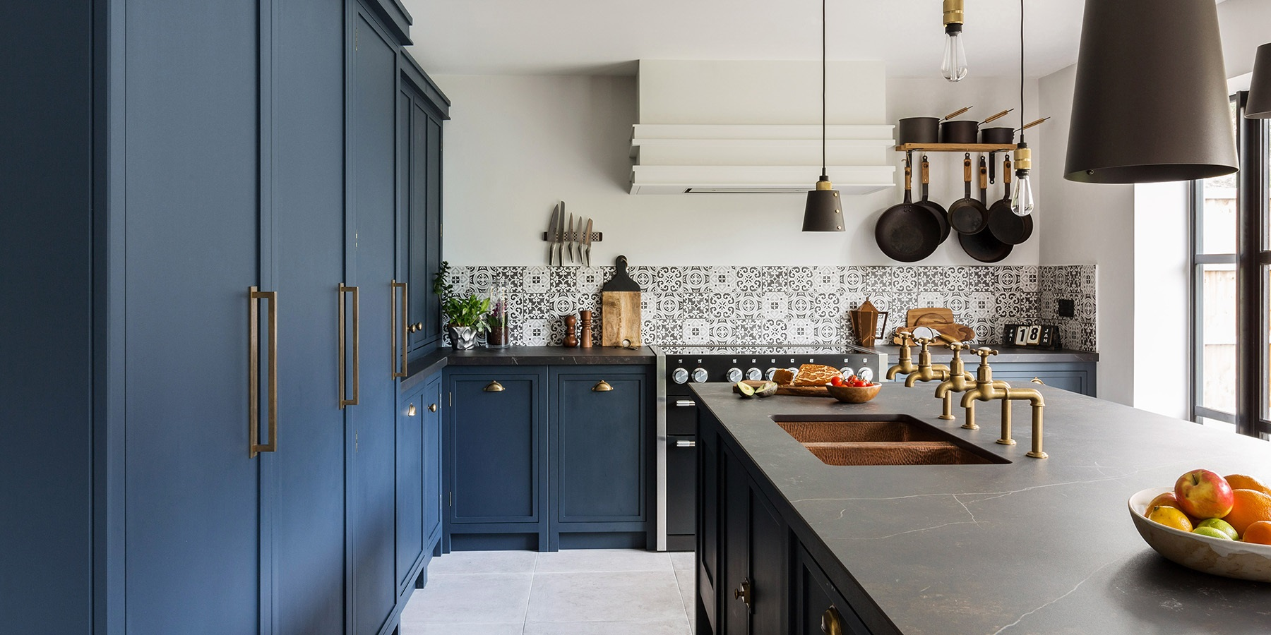 Industrial Navy Blue Shaker Kitchen - Beautiful Burlanes Decolane kitchen with larder unit and central island, with copper sink and Perrin & Rowe taps.