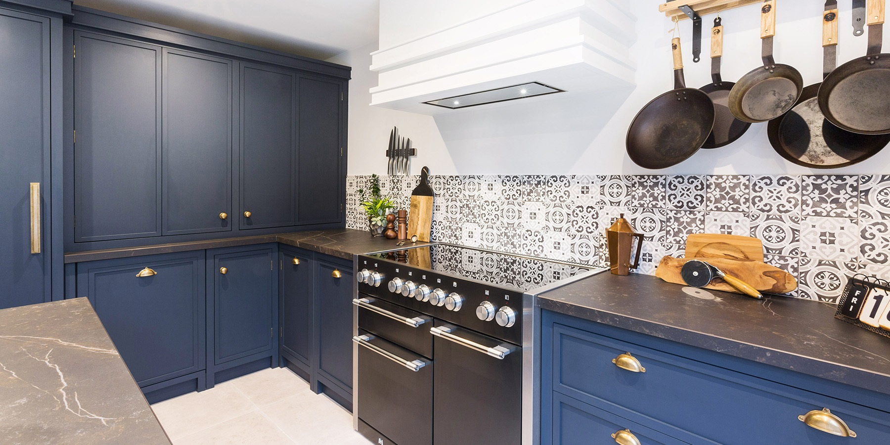 Industrial Navy Blue Shaker Kitchen - Burlanes Decolane kitchen in Navy, with Dekton worktops and Mercury range.