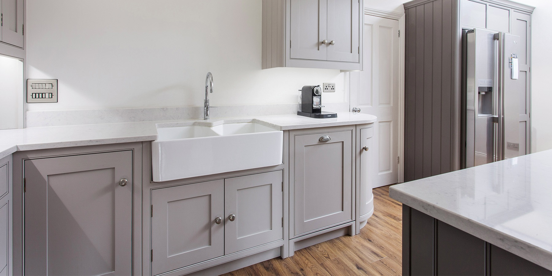 Freestanding Style Shaker Kitchen - Burlanes bespoke freestanding style Wellsdown grey kitchen with white worktops.