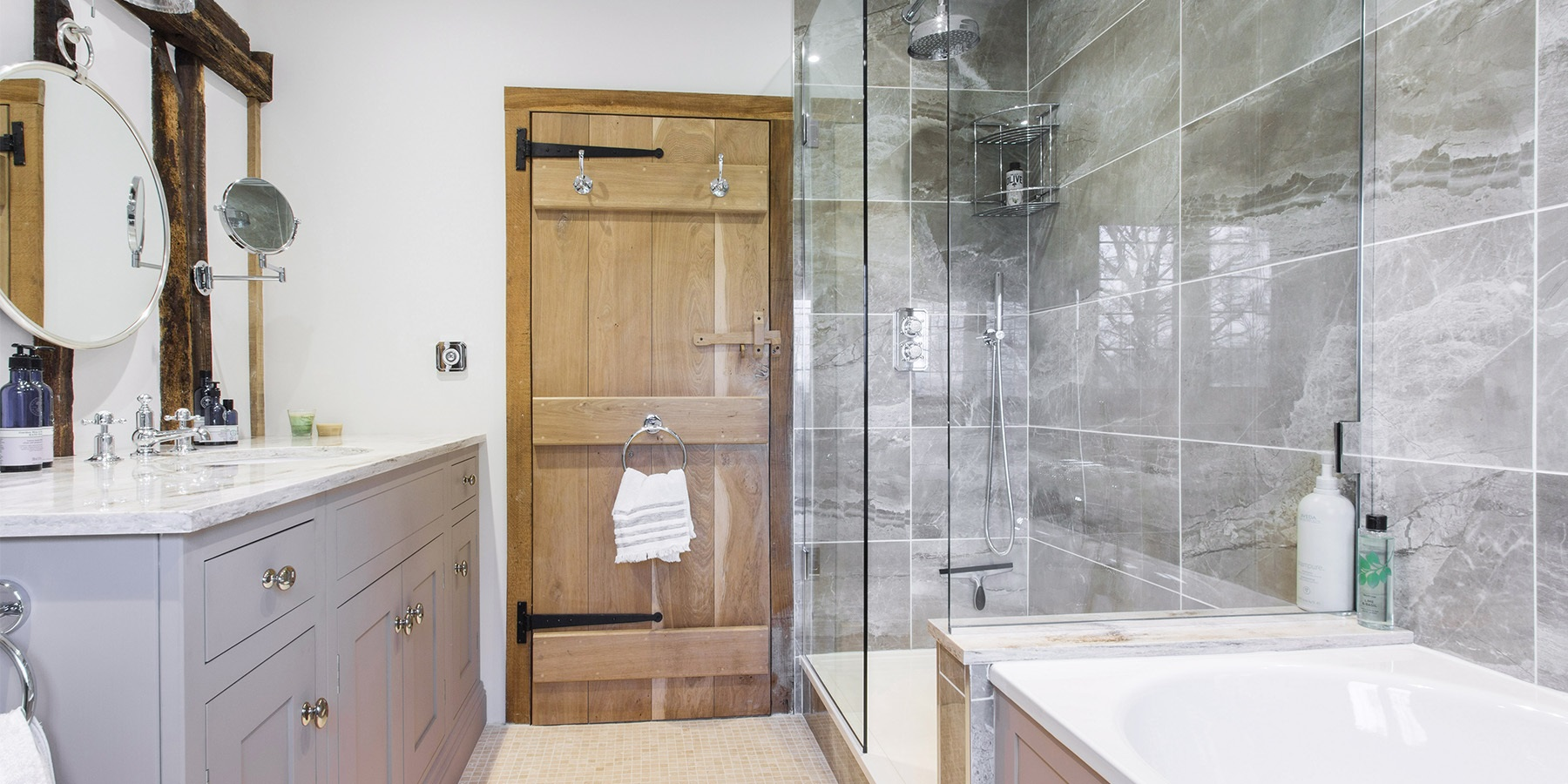Handmade Fitted Bathroom Furniture - Burlanes bespoke family bathroom design with walk-in shower and fitted bathtub panelling.