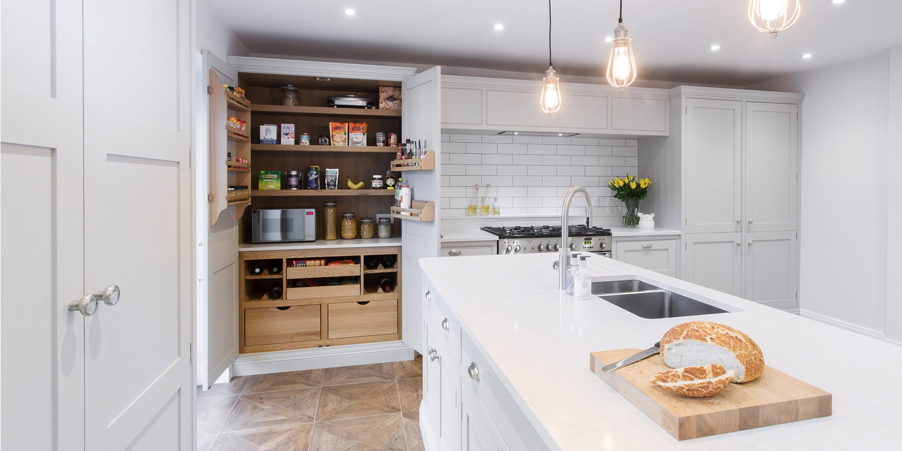 Burlanes Wellsdown Kitchen - Bespoke, handmade grey kitchen with larder unit and white worktops.