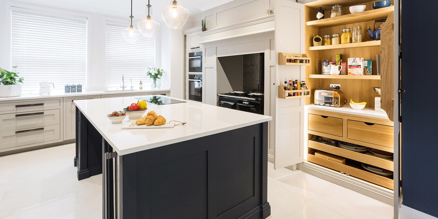 Classic grey and blue shaker kitchen - Burlanes handmade Wellsdown kitchen in grey, with blue central island and larder unit.